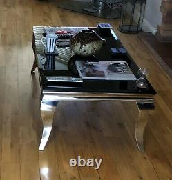 Coffee Table Chrome legs and base with black tempered glass top